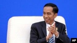 Presiden Joko Widodo dalam pertemuan di Beijing, Maret 2015.