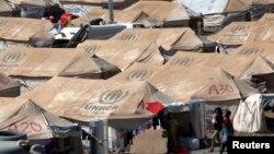 2013年8月26日敘利亞難民在伊拉克庫爾德斯坦地區埃爾比勒市郊外一個新建難民營。