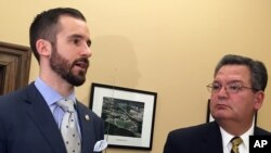 West Virginia Senate Majority Leader Ryan Ferns, R-Ohio, left, and House Education Chairman Paul Espinosa, R-Jefferson, discuss an agreement reached by a legislative conference committee for a 5 percent pay increase for striking teachers Tuesday, March 6, 2018, at the Capitol in Charleston, W.Va.