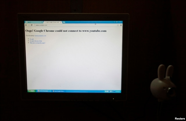 FILE - A computer screen shows the blocked site of Youtube at an internet cafe in Rawalpindi, Sept. 18, 2013.