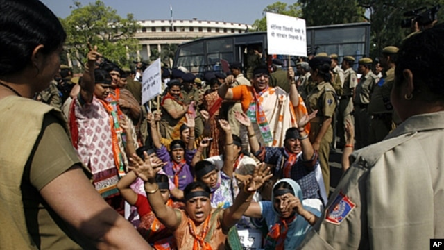 Women activists of India's main opposition Bharatiya Janata Party (BJP) shout slogans during a protest against the ruling government for the women's reservation bill in front of parliament in New Delhi, March 9, 2010.