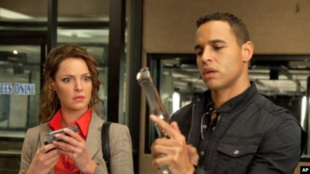 "Katherine Heigl and Daniel Sunjata in ""One For The Money."""