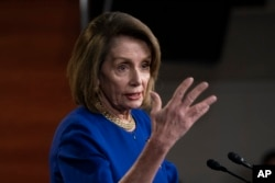 Speaker of the House Nancy Pelosi, D-Calif., talks with reporters during her weekly news conference, on Capitol Hill in Washington, Thursday, Feb. 7, 2019.