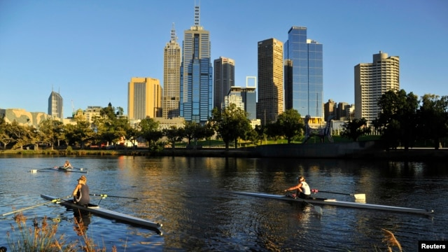 FILE - Rowers train at dawn on the Yarra River in Melbourne, Australia, Jan. 24, 2012.