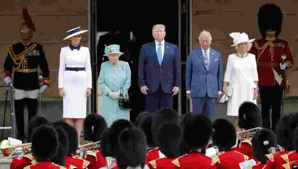 Britain's Queen Elizabeth II stands with President Donald Trump, center, and first lady Melania Trump, left, Britain's Prince Charles and Camilla, Duchess of Cornwall, right, during a ceremonial welcome in the garden of Buckingham Palace, June 3, 2017.