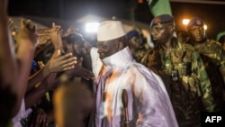 Incumbent Gambian President Yahya Jammeh greets his suporters in Bikama, Nov. 24, 2016 during an electoral rally.