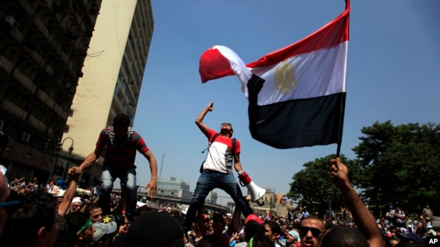 Supporters of Egypt's ousted President Mohamed Morsi chant slogans during a protest in Ramses Square in downtown Cairo, Egypt, Aug. 16, 2013.