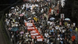 "Marches in Hong Kong on Sunday, July 29, 2012 protest Beijing-approved ""national education"" plans."