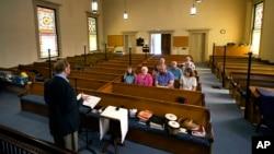 Minister Greg Foster delivers a sermon at Waldoboro United Methodist Church, Sunday, June 20, 2021, in Waldoboro, Maine. (AP Photo/Robert F. Bukaty)