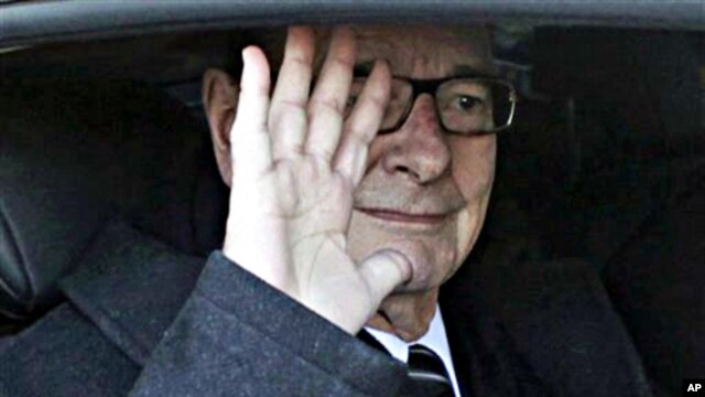Former French President Jacques Chirac leaves his office in Paris, March 7, 2011