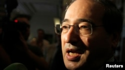 Syria's Deputy Foreign Minister Faisal al-Meqdad is seen in a August 23, 2012, file photo.