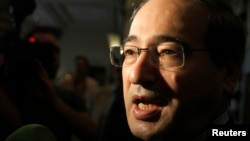 Thứ trưởng Ngoại giao Syria Faisal al-Meqdad is seen in a August 23, 2012, file photo.