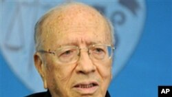 Tunisian interim Prime Minister Beji Caid Essebsi addresses reporters during a press conference held at the presidential palace in Carthage, outside Tunis, March 7, 2011