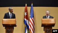 FILE - President Barack Obama (L)and Cuban President Raul Castro hold a joint press conference after meeting at the Revolution Palace in Havana, March 21, 2016.