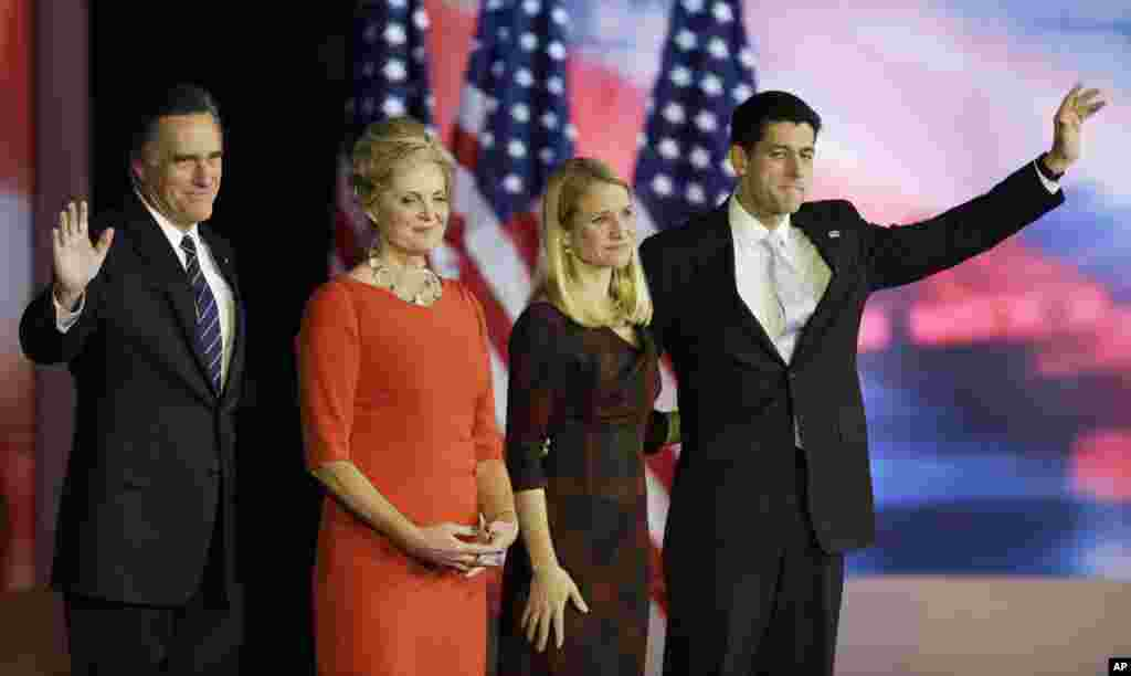 Republican presidential candidate Mitt Romney and his wife Ann stand on the stage with Republican vice presidential candidate Paul Ryan,and his wife Janna during his election night rally, November 7, 2012, in Boston, Massachusetts.