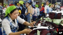 Cambodian garment workers work inside a factory in Phnom Penh, file photo.