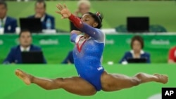 The United States' Simone Biles performs on the floor during the artistic gymnastics women's apparatus final at the 2016 Summer Olympics in Rio de Janeiro, Brazil, Aug. 16, 2016.