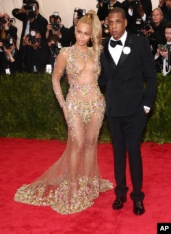 "Beyonce, left, and Jay-Z arrive at The Metropolitan Museum of Art's Costume Institute benefit gala celebrating ""China: Through the Looking Glass"" on May 4, 2015, in New York."