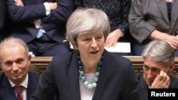 La Première ministre britannique Theresa May, à la Chambre des communes, le 10 décembre 2018. Document télévisé du Parlement via REUTERS