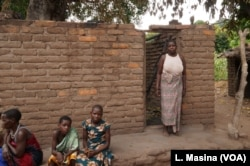 Aidah Waisoni standing outside his burnt house in Phalombe district.