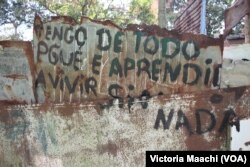 """""""I have everything, because I've learned to live without anything,"""" reads a sign near Calabazar, on the outskirts of Havana, Cuba."""