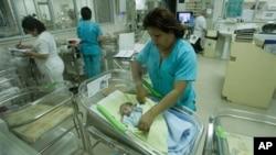 Nurses attend newborn babies at the Maternity hospital in Lima, Peru, Monday, Oct. 31, 2011. (AP Photo/Karel Navarro)