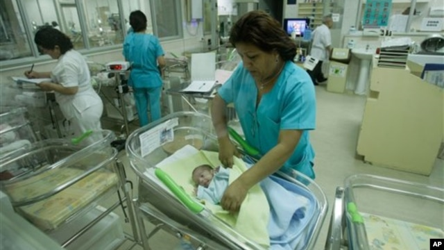 Nurses attend newborn babies at the Maternity hospital in Lima, Peru, Monday, Oct. 31, 2011. (AP Photo/Karel Navarro)