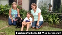 Hollie Mallet, her dog Dutchess, and Josh and Ginger Breaux pose for a photo after their video went viral.