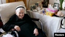 FILE - National heroine and Nobel Peace Prize nominee Irena Sendler sits in a chair at her home in central Warsaw, March 14, 2007.