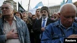 Krım tatarları Stalin deportasiyalarının ildönümünü anır. 18 may, 2015. Sovet hökumətinin başlatdığı kütləvi sürgün zamanı minlərlə adamın həlak olduğu təxmin edilir.