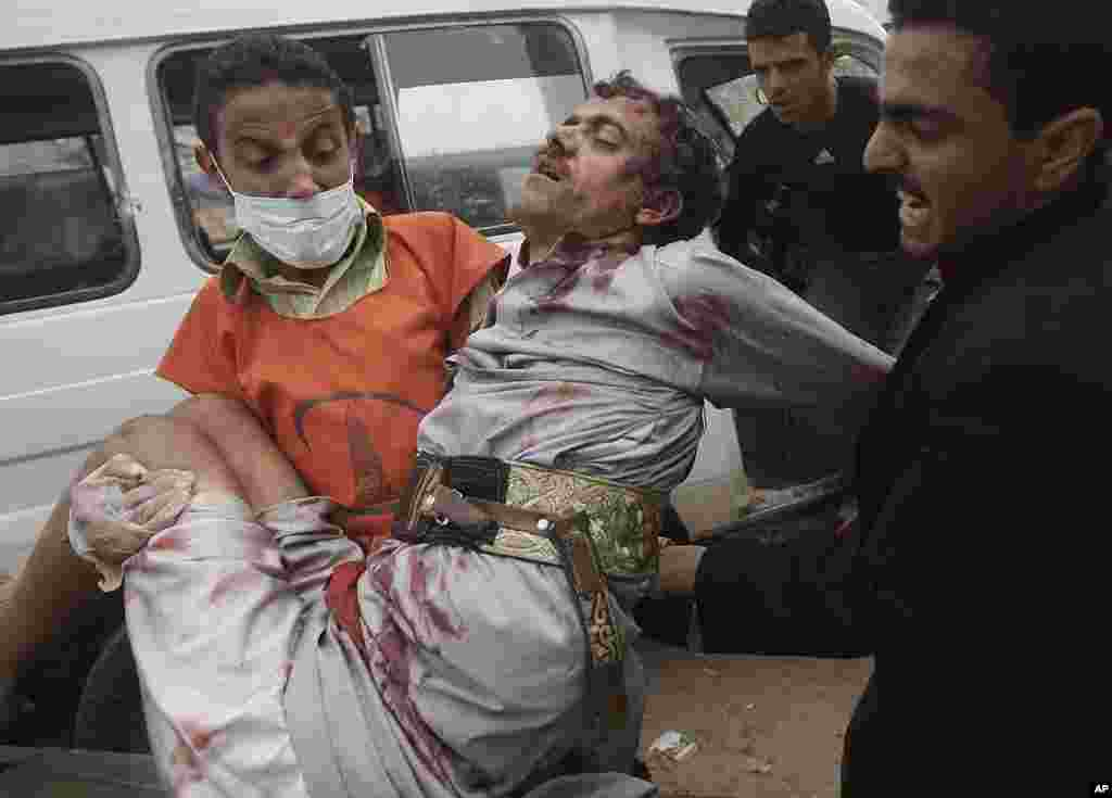 A wounded protester is carried from the site of clashes with security forces in Sanaa, Yemen, November 24, 2011. (AP)