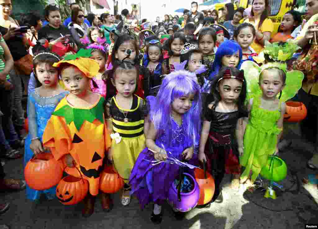 Students of Brainshire Science School wear costumes as they participate in a halloween parade in Paranaque city, metro Manila, Oct. 30, 2015.