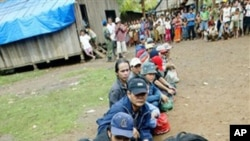 Montagnards from neighbouring Vietnam await registration by United Nations High Commissioner for Refugees staff in Korng village, Ratanakiri province, in 2004.