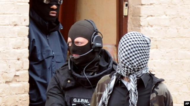 French members of the French National Police Intervention Group (GIPN) arrest a suspected radical Islamist group member, on April 4, 2012, in Roubaix.