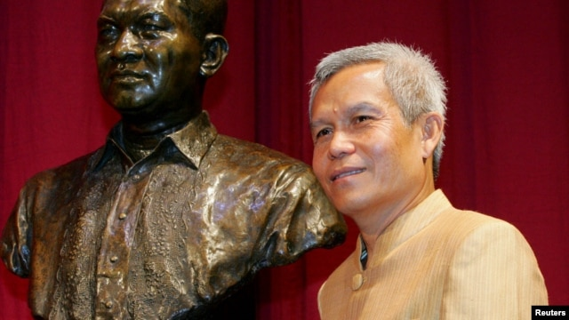 In this August 31, 2005 photo, Sombath Somphone of Laos, winner of Ramon Magsaysay Award for Community Leadership in 2005, poses prior to receiving his award in Manila.