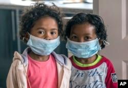 Children wear face masks at a school in Antananarivo, Madagascar, Oct. 3, 2017.