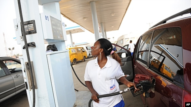 A  fuel attendant fills a tank at a gas station on Lagos' Ibadan highway where new pump prices were implemented. Queues formed at petrol stations, protests broke out and unions threatened to paralyze Nigeria over a deeply controversial measure that has mo