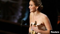 "Actress Jennifer Lawrence accepts the award for best actress for her role in ""Silver Linings Playbook"" at the 85th Academy Awards in Hollywood, California Feb. 24, 2013."