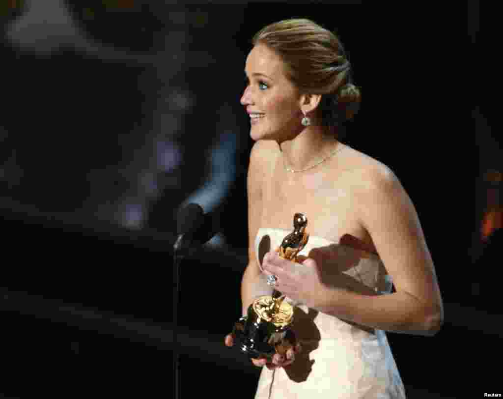 "Actress Jennifer Lawrence accepts the award for best actress for her role in ""Silver Linings Playbook""."