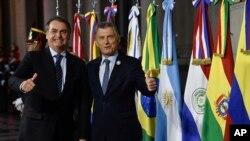 Mauricio Macri,a la derecha, se mostró muy cercano al presidente Jair Bolsonaro durante su mandato.