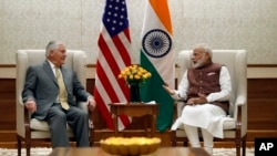 Secretary of State Rex Tillerson listens to Indian Prime Minister Narendra Modi during their meeting at the Prime Minister's residence in New Delhi, India, Oct. 25, 2017.