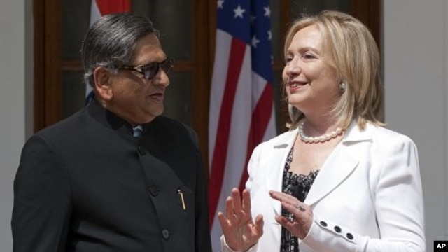 Indian Foreign Minister S.M. Krishna, left, speaks with U.S. Secretary of State Hillary Rodham Clinton prior to the start of the U.S.-India Strategic Dialogue at Hyderabad House in New Delhi, July 19, 2011