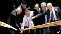 Hollywood actor Robert De Niro, second from right, joins his partners Japanese culinary Chef Nobu Matsuhisa, third from left, Hollywood film producer Meir Teper, left, and Melco Crown Entertainment casino executives James Packer, second from left, and Lawrence Ho, fourth from left, in ribbon-cutting ceremony at the opening of their Nobu Hotel at the City of Dreams Casino Monday, May 18, 2015 at suburban Pasay city, south of Manila, Philippines.