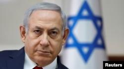 Israel's Prime Minister Benjamin Netanyahu chairs the weekly Cabinet meeting in Jerusalem, Nov. 18, 2018.