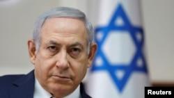 Perdana Menteri Israel Benjamin Netanyahu pada rapat mingguan kabinet di Yerusalem, 18 November 2018.