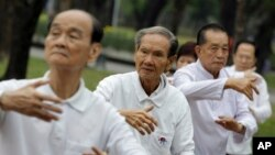 FILE - Elderly men exercise at a park in Bangkok, Thailand, Dec. 16, 2011. Healthcare costs could total $20 trillion over next 15 years, threatening future growth in Asia.