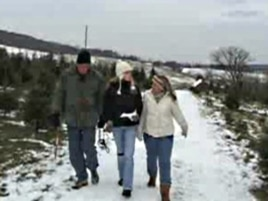 The Sylvester family strolls on a farm in Round Hill, Virginia in search of the perfect Christmas tree.