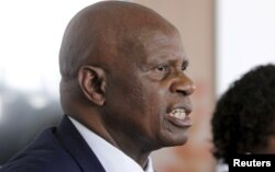 "FILE - Zimbabwe's Finance Minister Patrick Chinamasa says that ""there is need for a change of attitude by our banks to reflect our economic realities."""