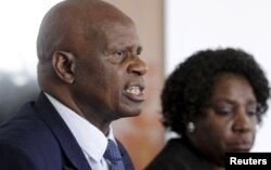 Zimbabwe's Finance Minister Patrick Chinamasa (L) addresses a media conference after meeting International Monetary Fund (IMF) Executive Director for Africa Chileshe Kapwepwe (R) in Harare, September 7, 2015.