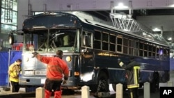 A bus is towed away after a gunman fired shots at US soldiers on the bus outside Frankfurt airport, Germany, March 2, 2011